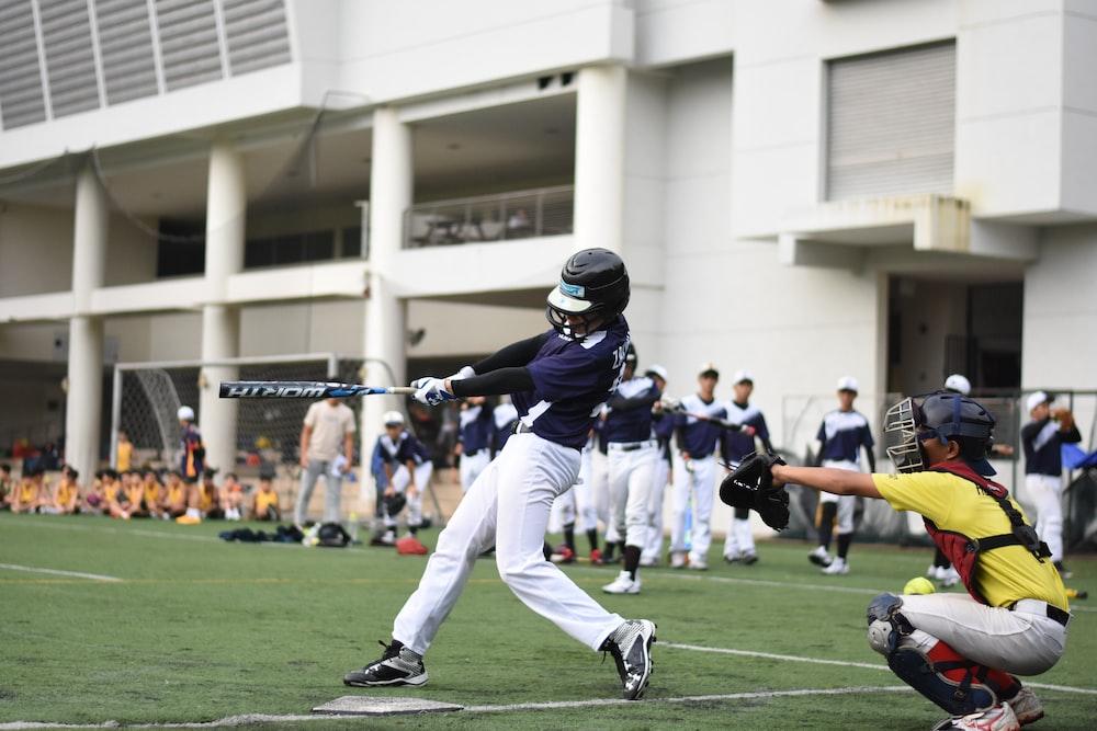 baseball players playing baseball on baseball field