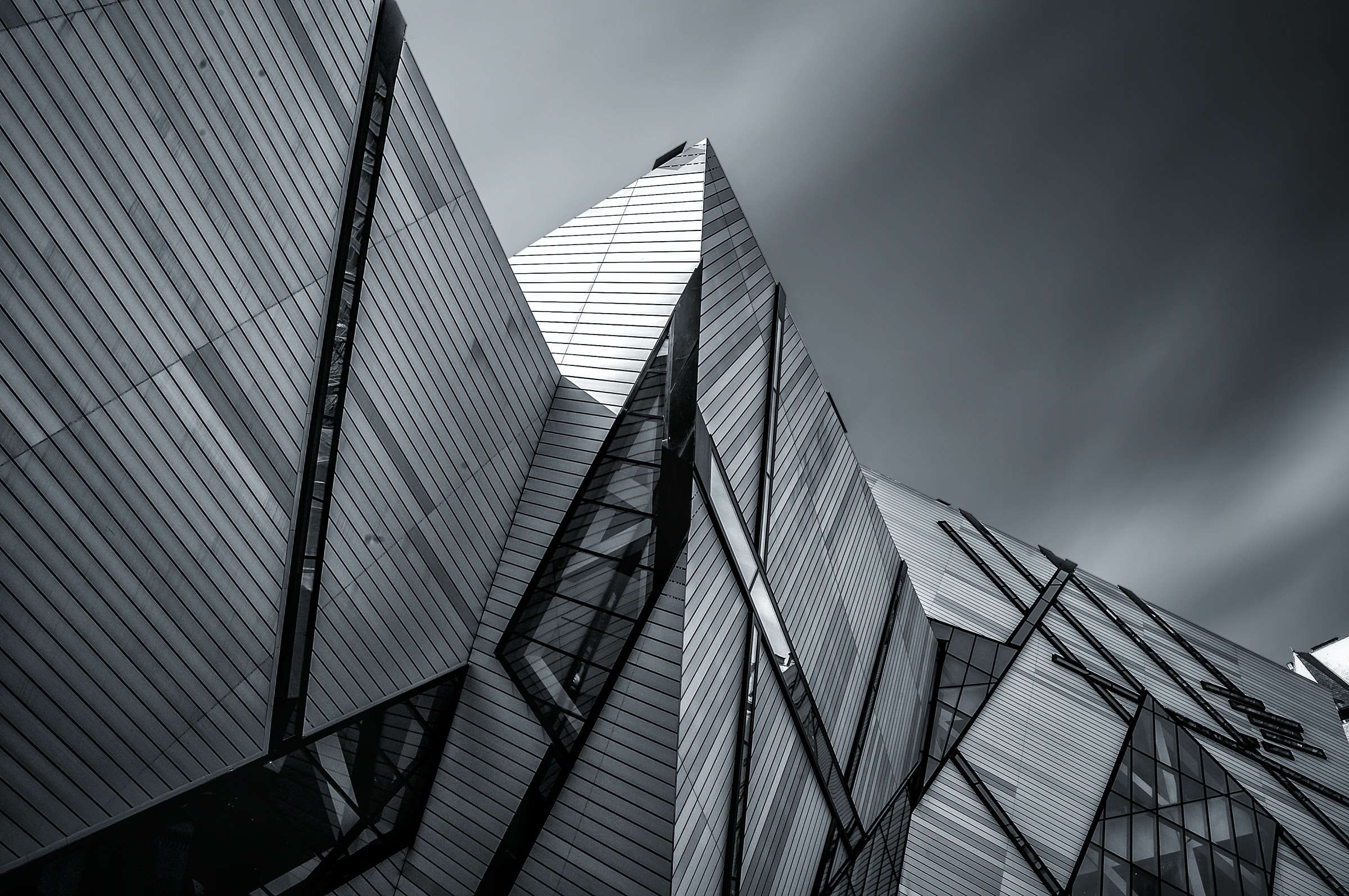 Royal Ontario Museum modern, futuristic architecture with gray sky and clouds