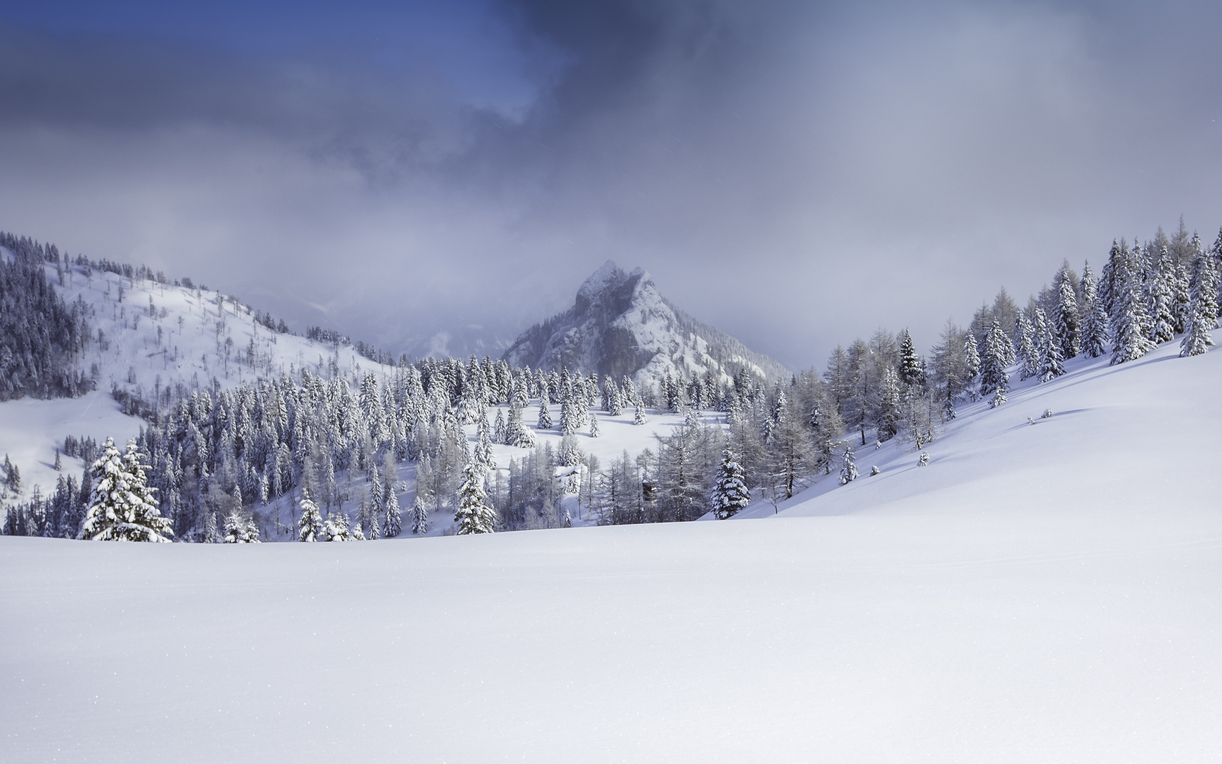 A background consisting of a foggy sky at the winter alps in Postalm