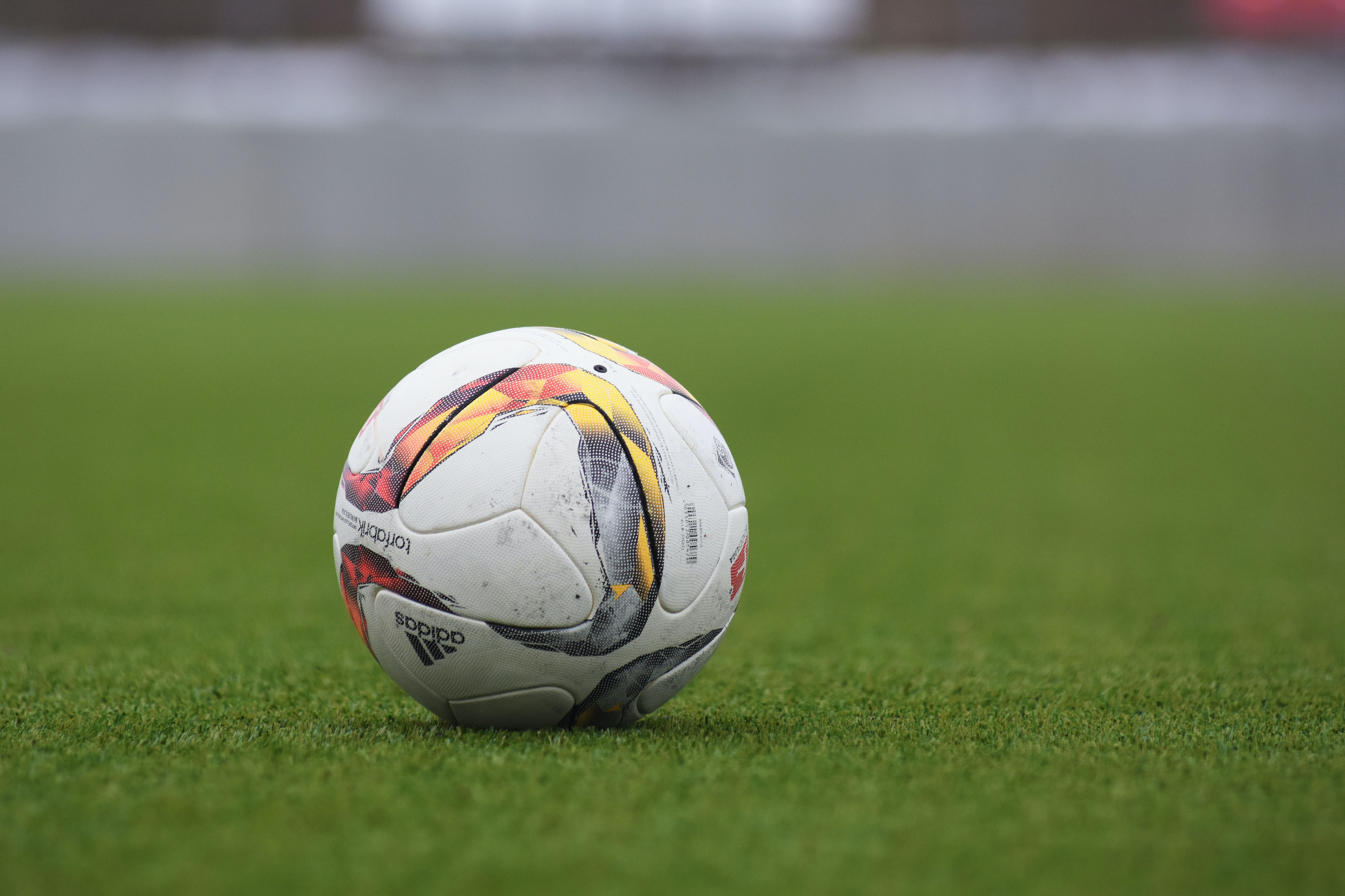 A soccer ball on the grass on a field
