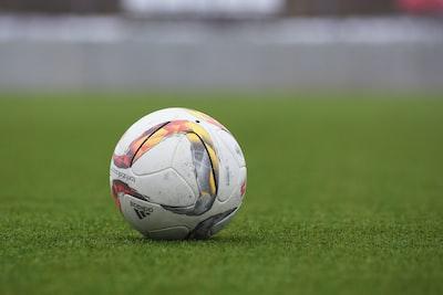 white and gray Adidas soccerball
