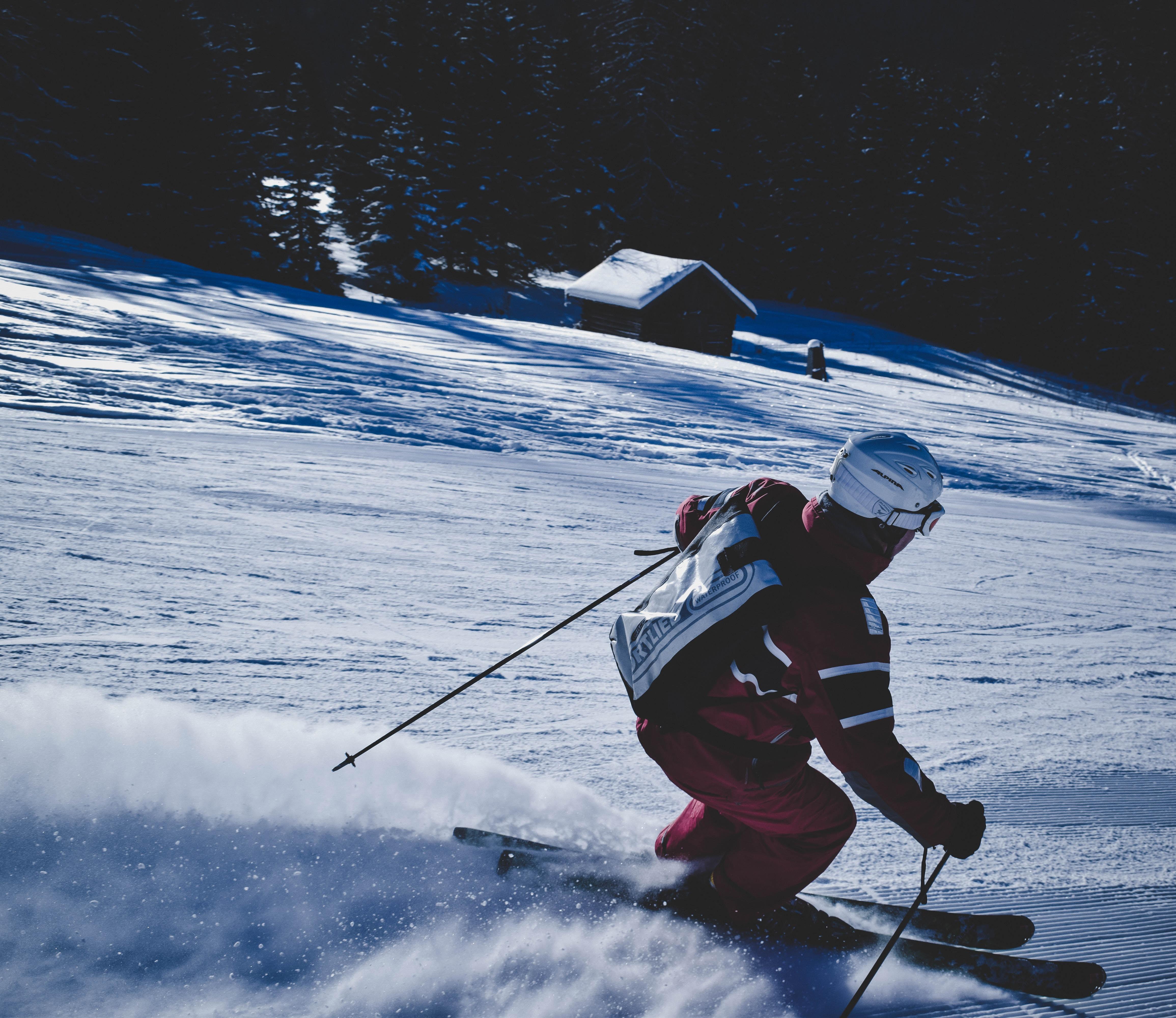 A skier going down a snowy slope in Garmisch-Partenkirchen