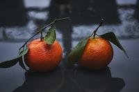 two round orange fruits