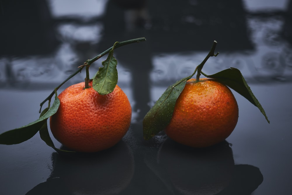 two round orange fruits