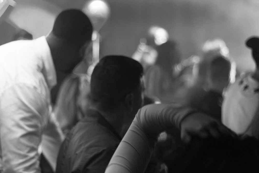 grayscale photography of people gathering in event