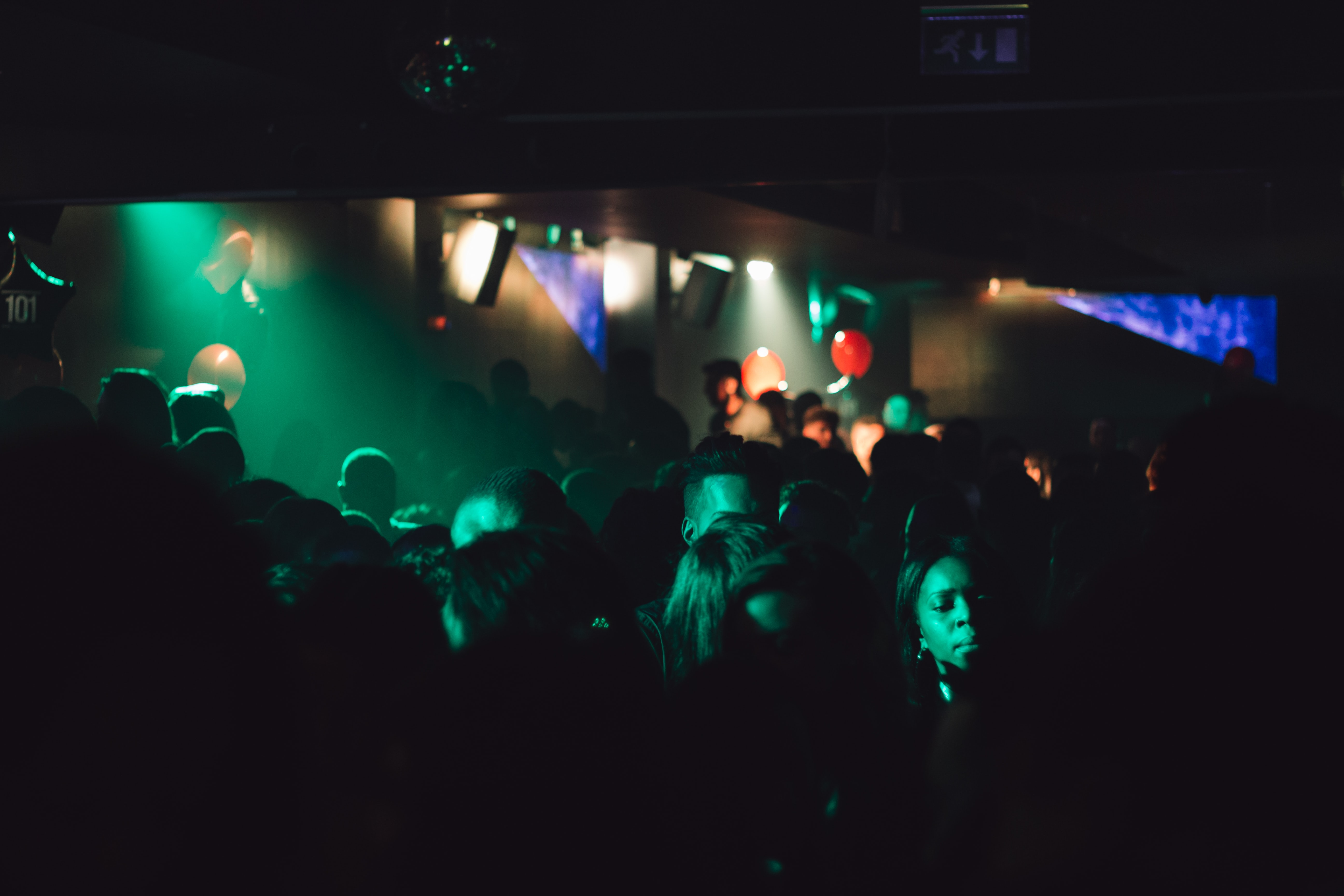 People dancing in a dark night club at the Birmingham Hippodrome in the United Kingdom
