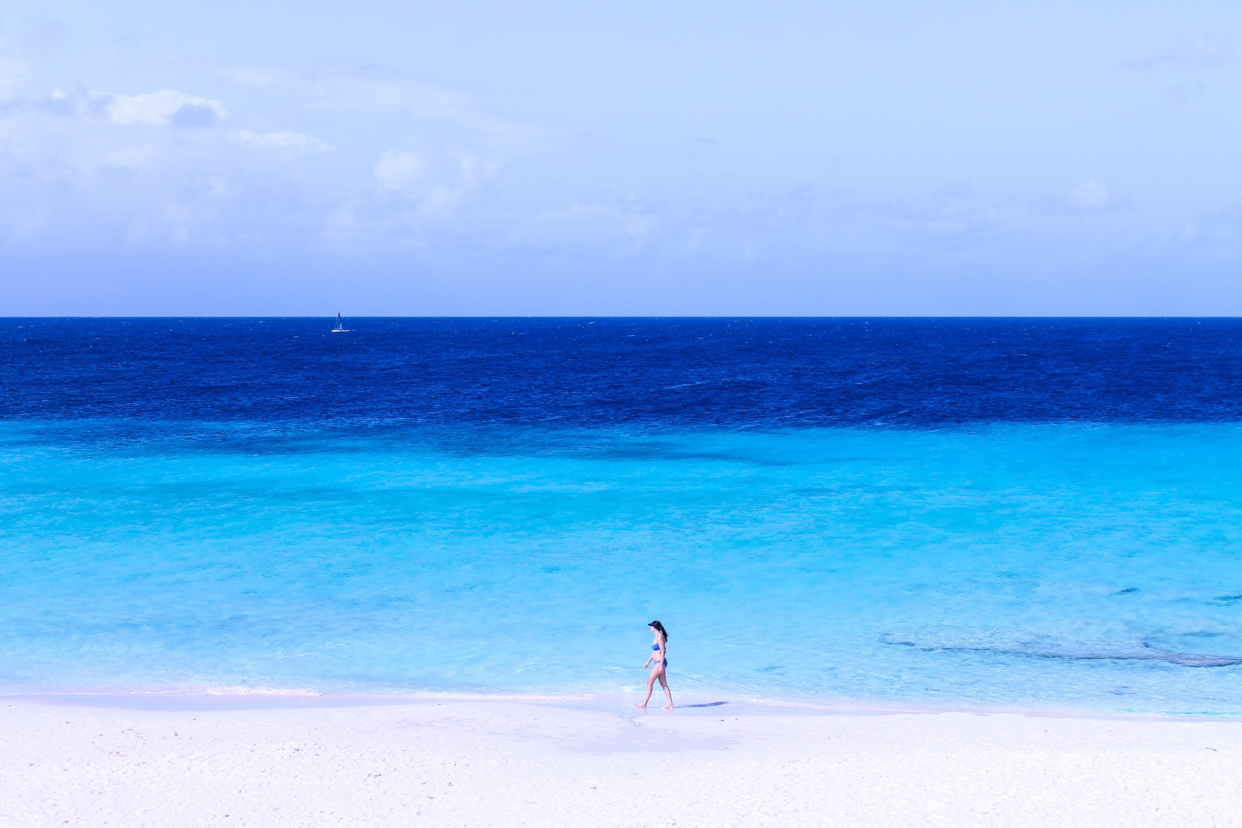 woman walking on seashore
