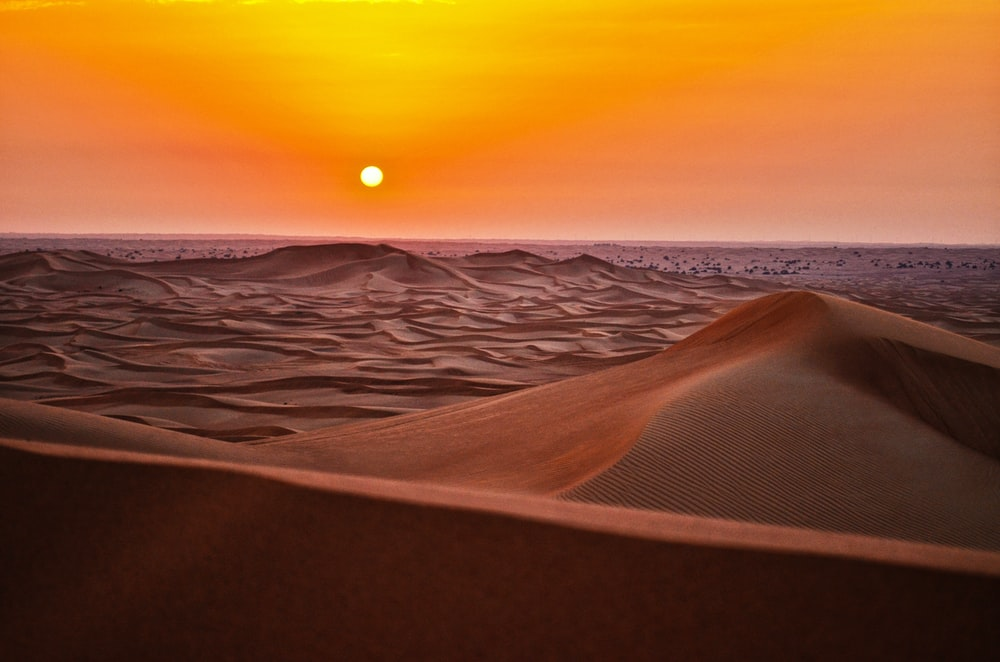 sand dunes during sunset