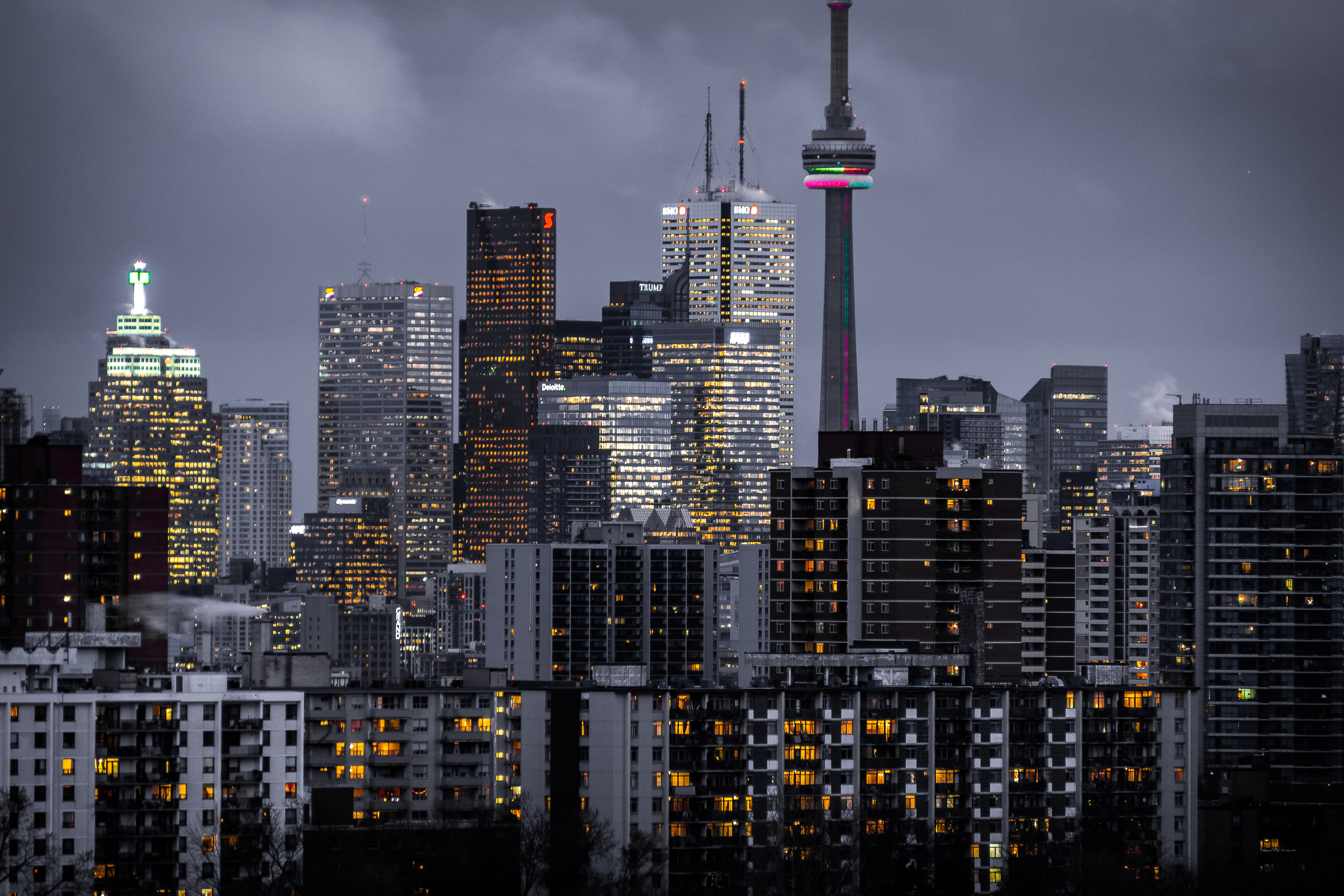 Lights in the windows of high-rises in Toronto on a cloudy evening