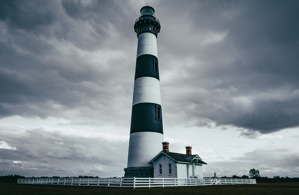 grayscale photography of light house