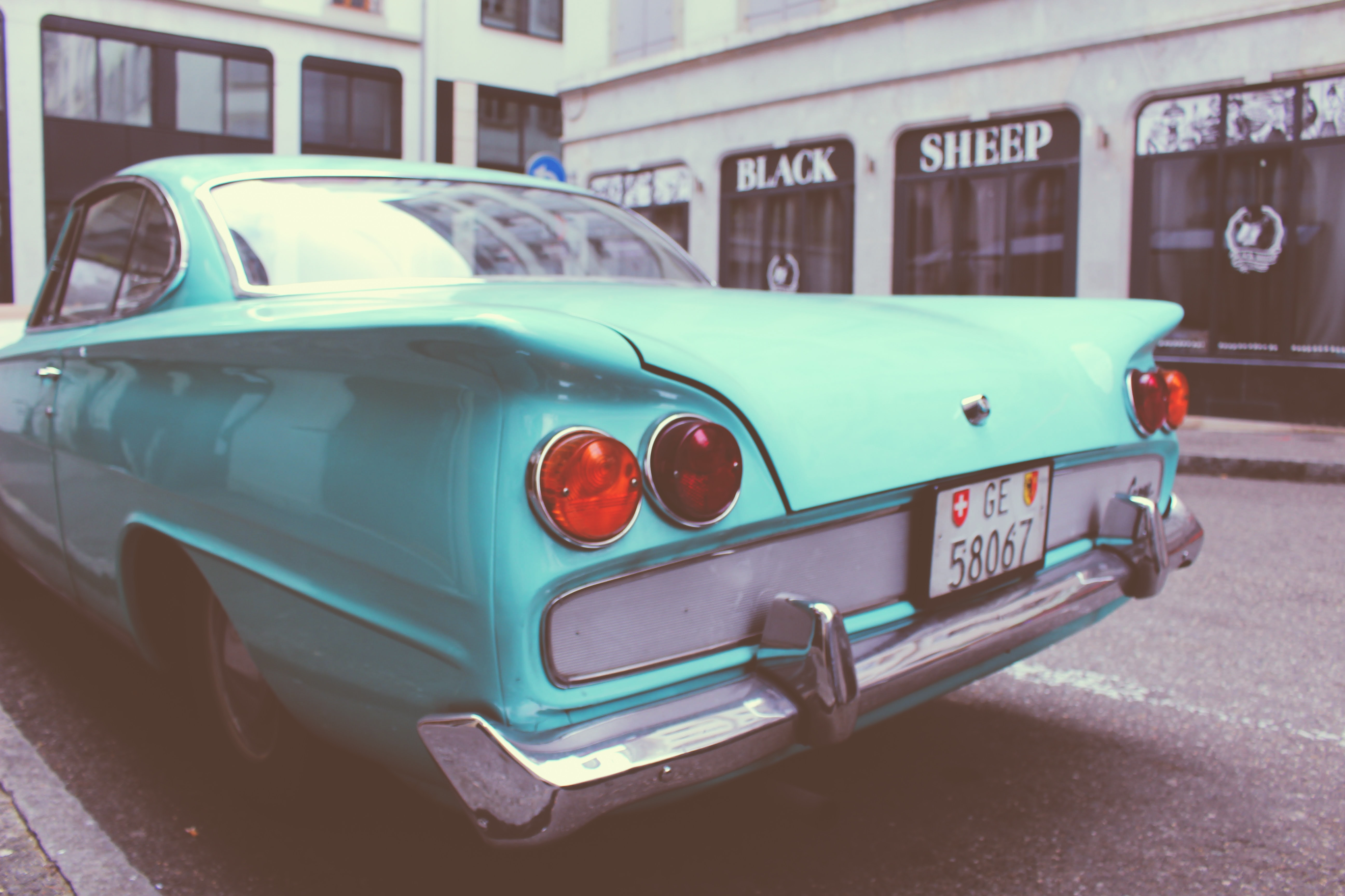 Turquoise vintage car in a moody tone.