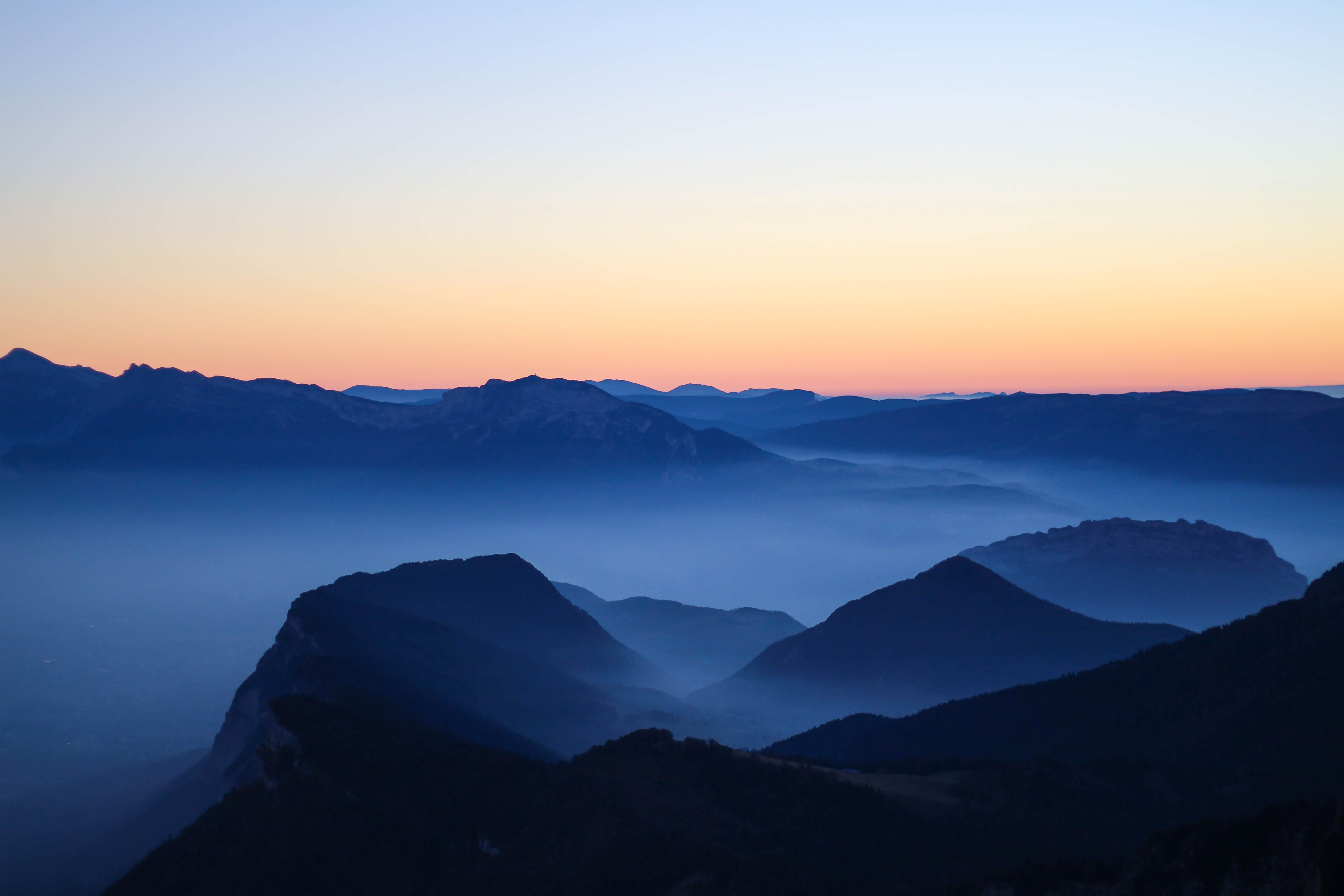 silhouette photo of mountain during dawn