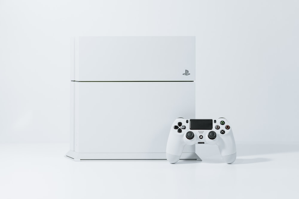 white Sony PS4 Original with controller