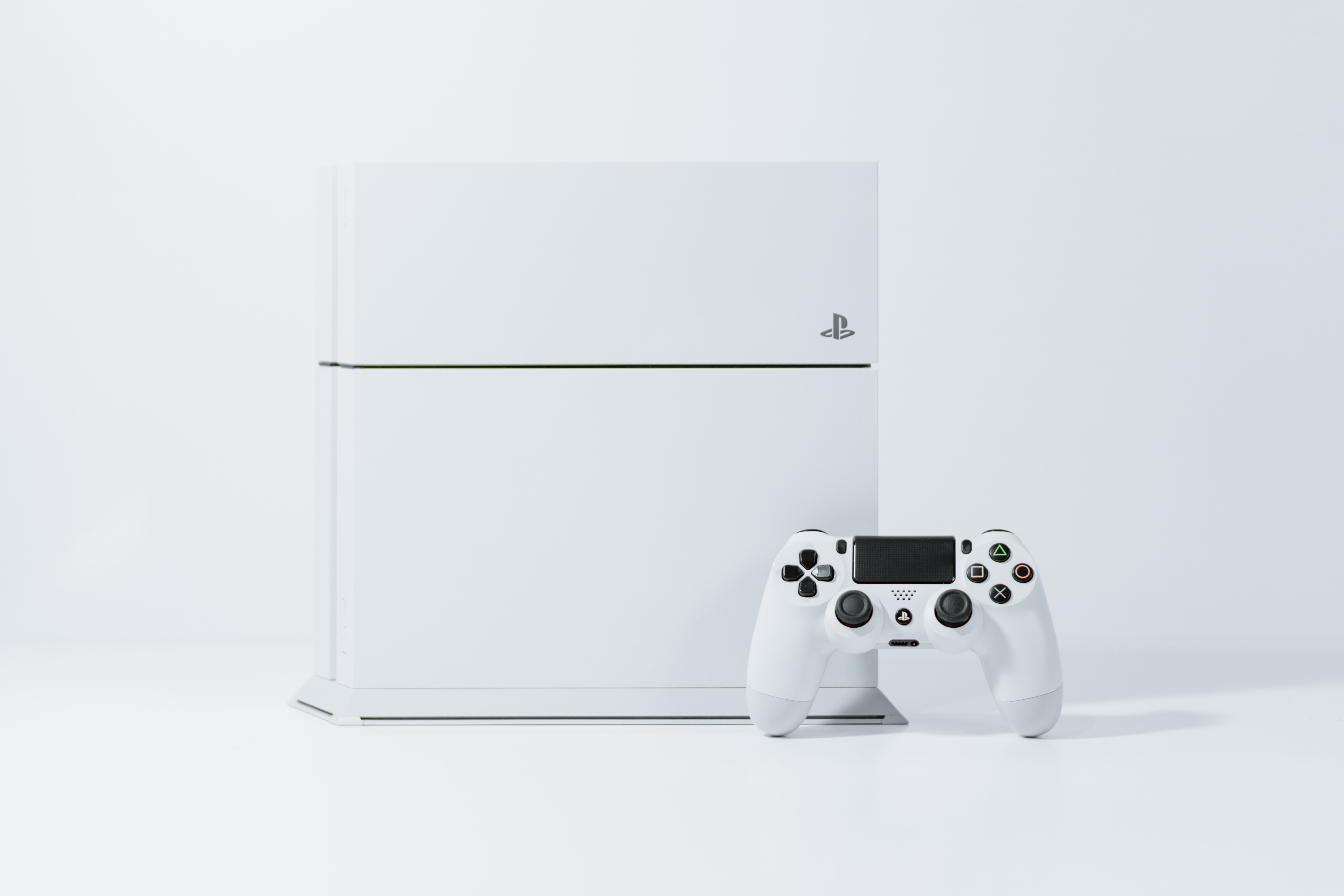 A close up shot of a white PS4 gaming system
