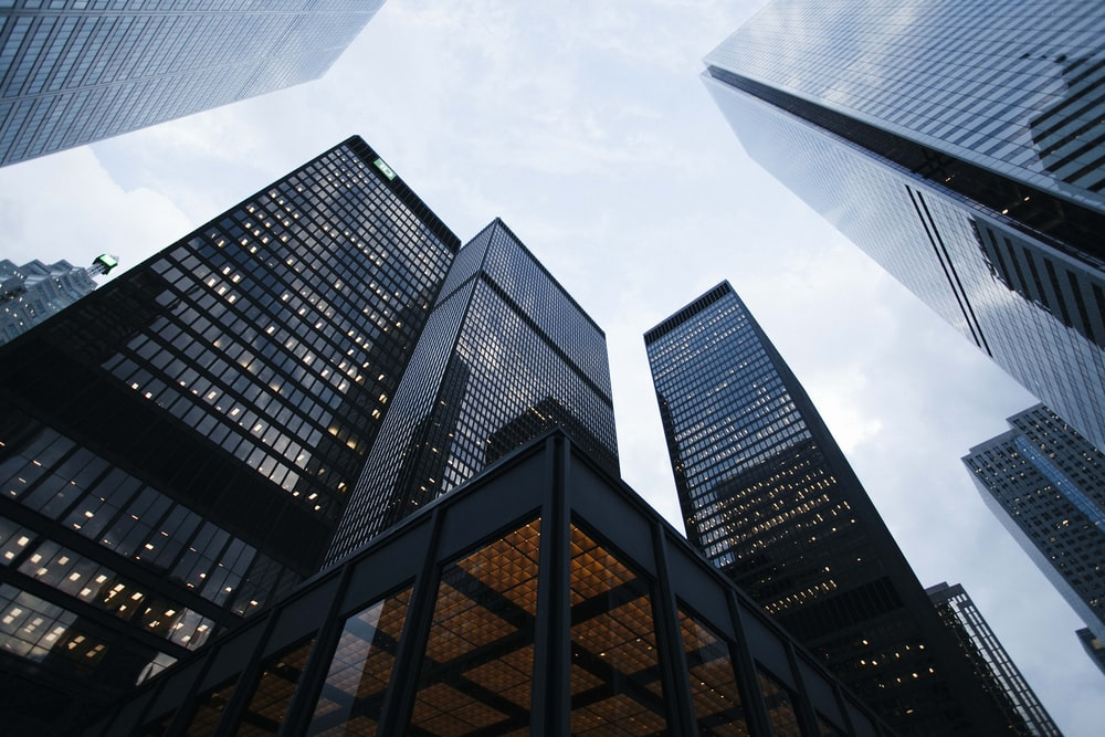 A low-angle shot of several skyscrapers in a city