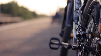 selective focus photograph of bicycle bike zoom background