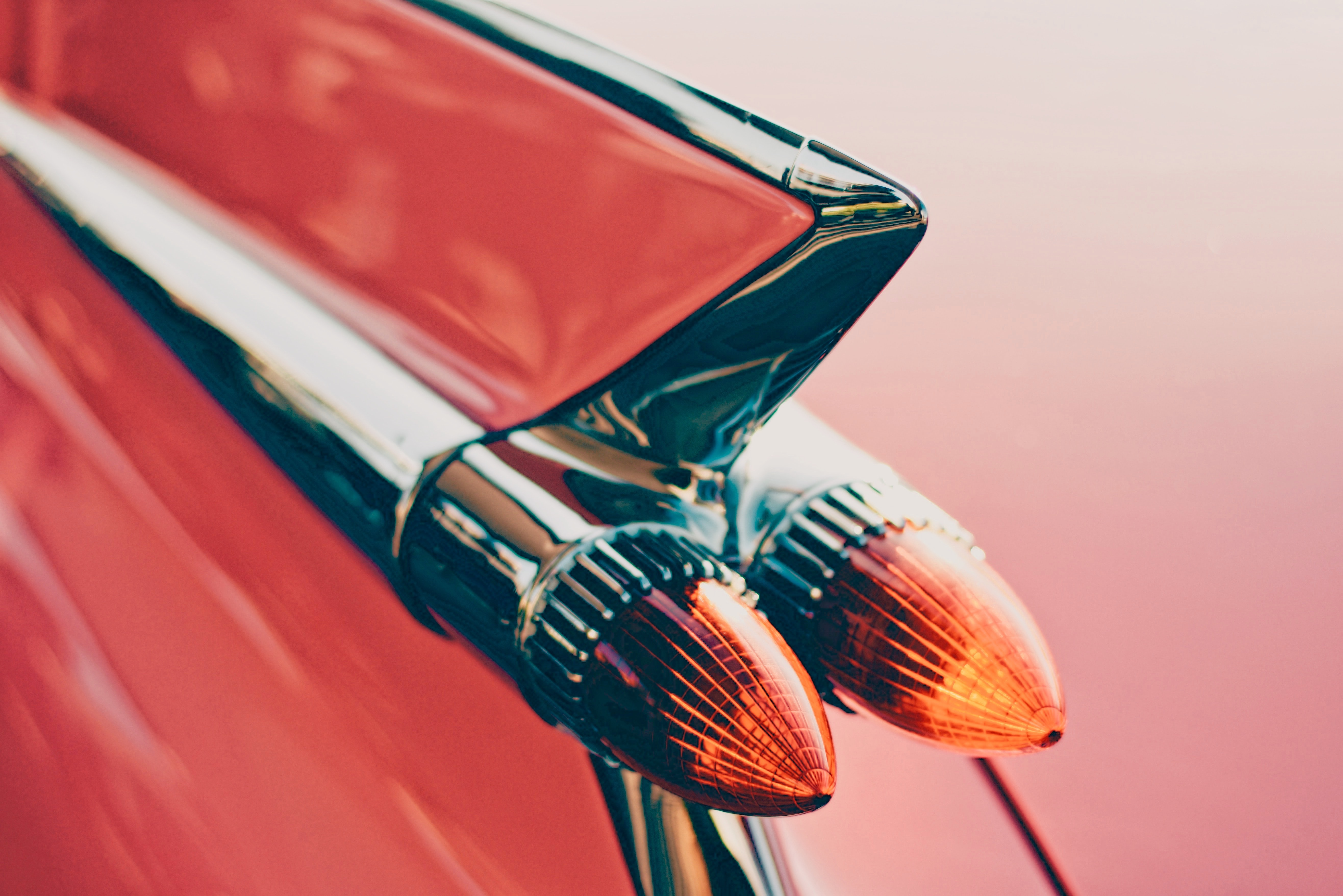 Close-up of a glossy part of a red car body
