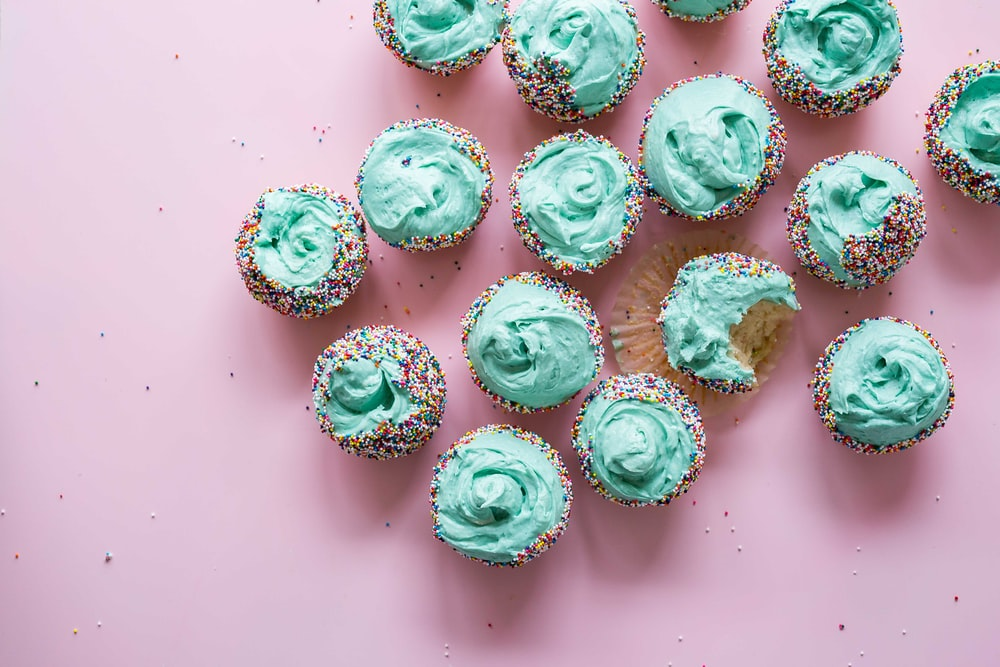 cupcake with teal icing lot