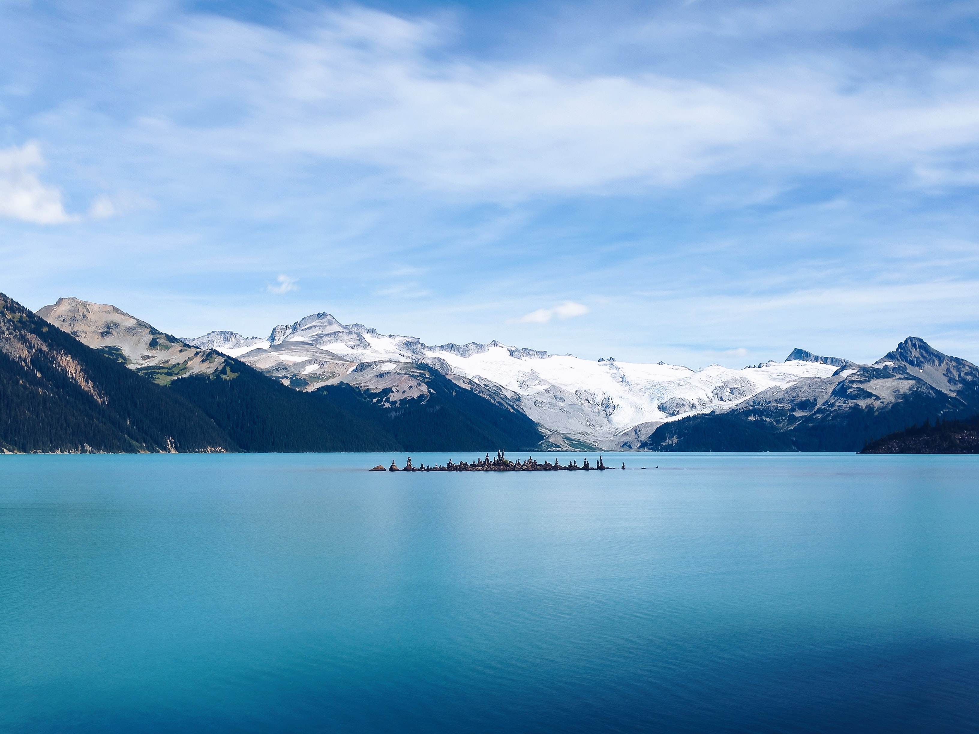 View from the azure Garibaldi Lake on a snowy mountain range