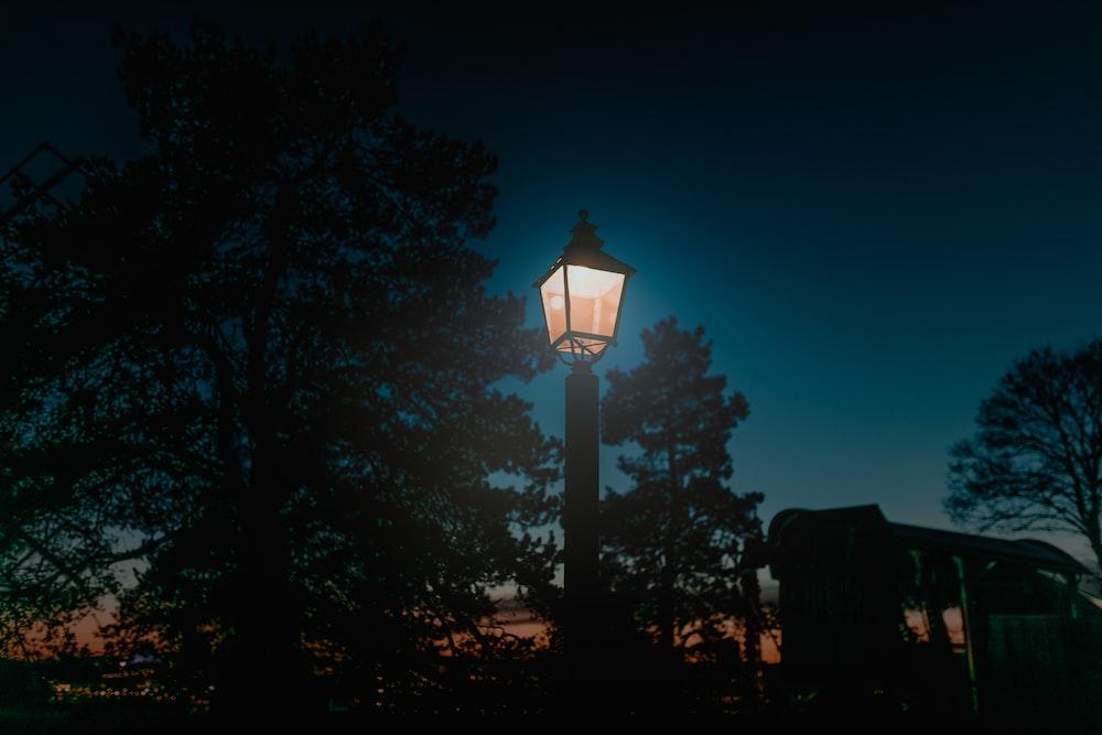 turned-on lantern post