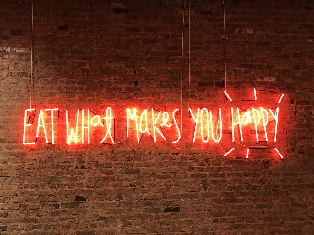 lighted eat what makes you happy neon signage
