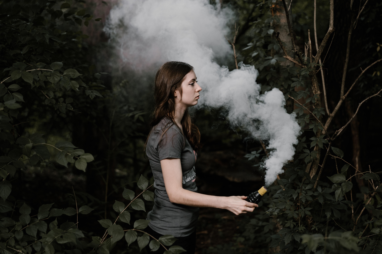 woman holding smoking bar