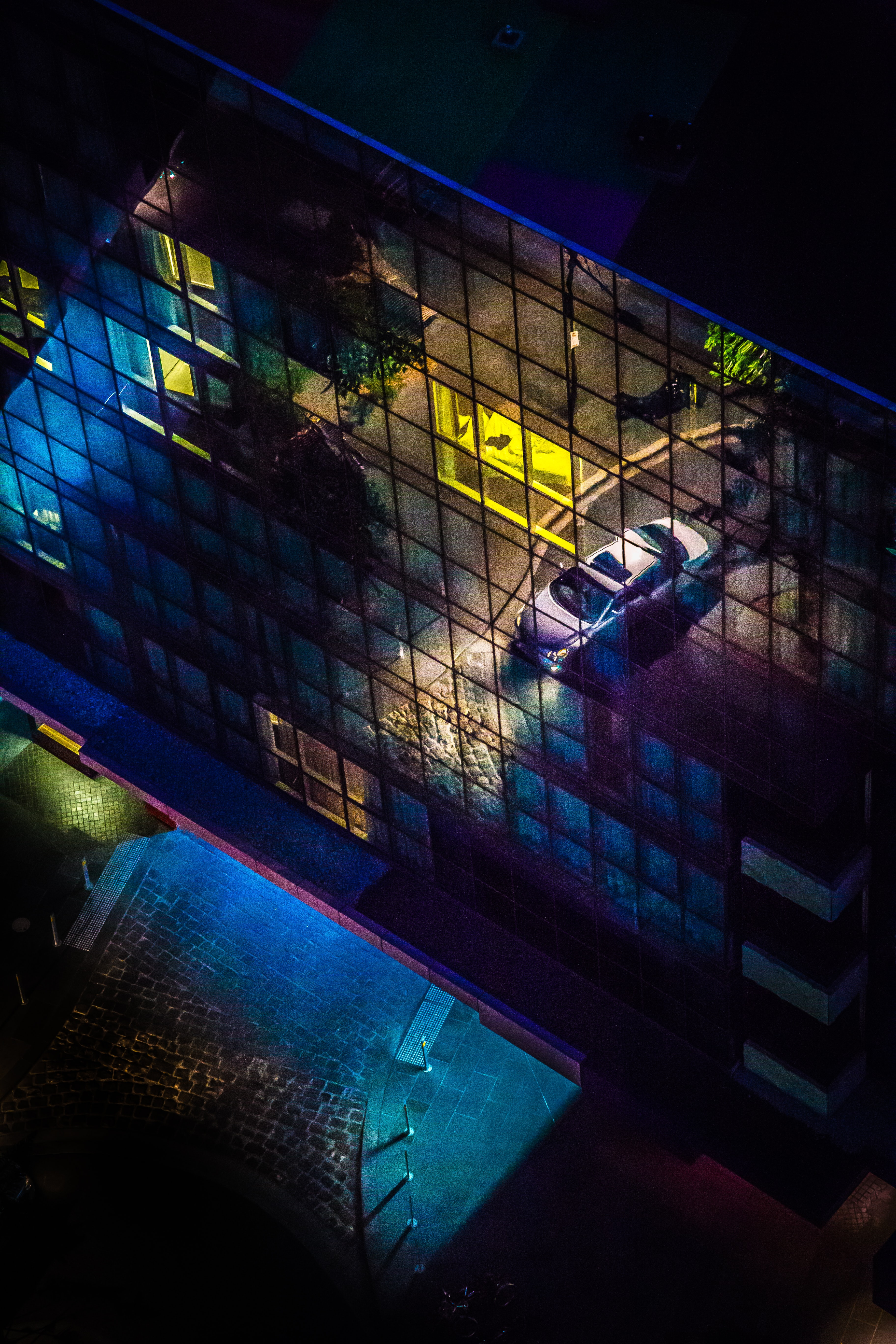 Reflection of car illuminated on building exterior in Docklands