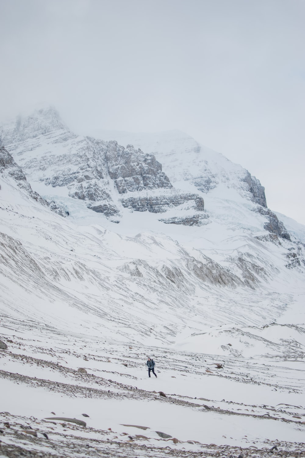 person trekking on icy mountain