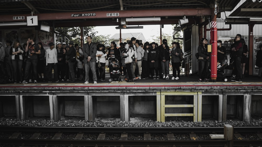 people standing in train station