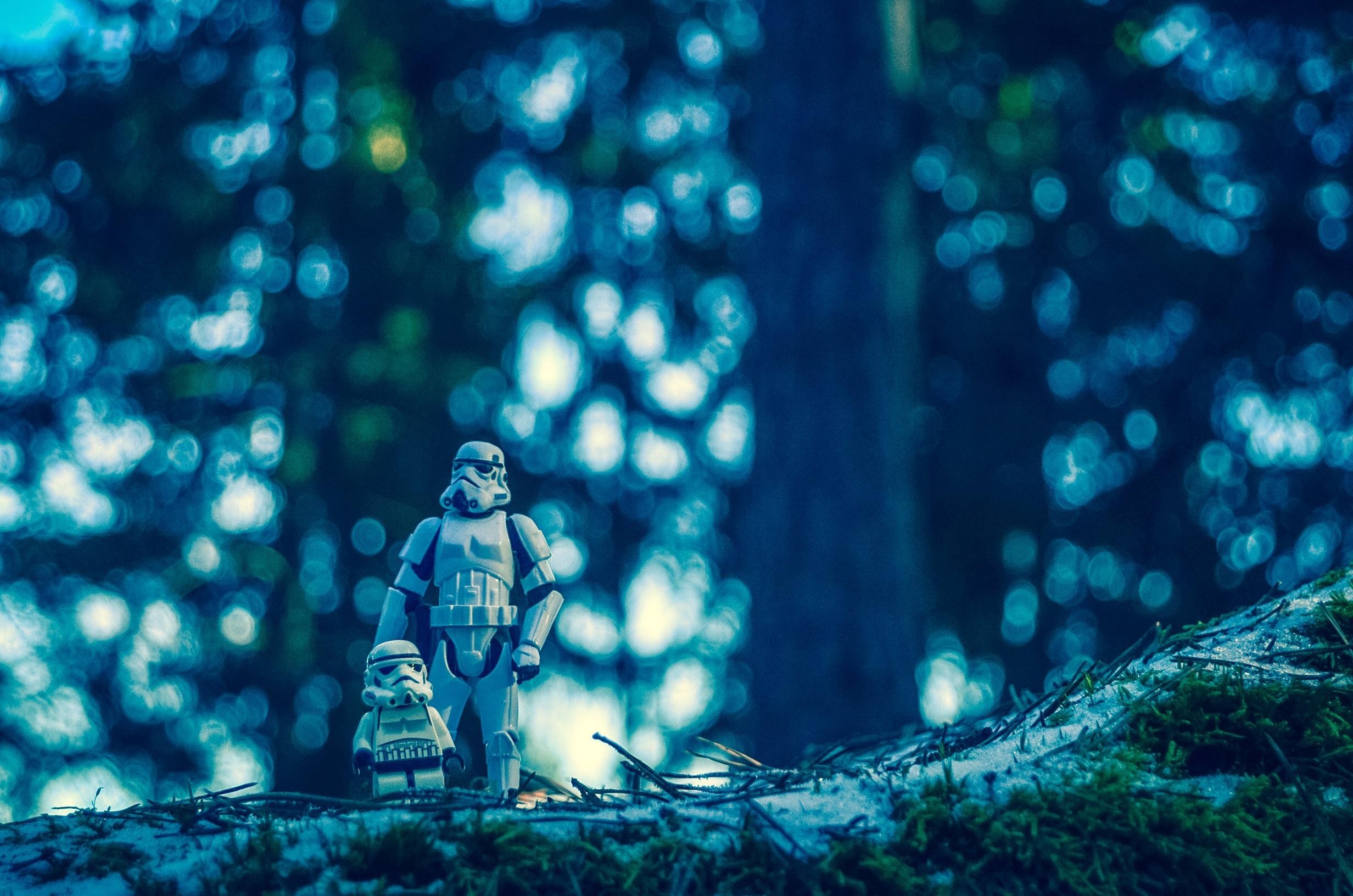 A Clone Trooper figure and a Lego Clone Trooper walking in the woods.