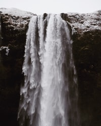time lapse photography of waterfall during daytime