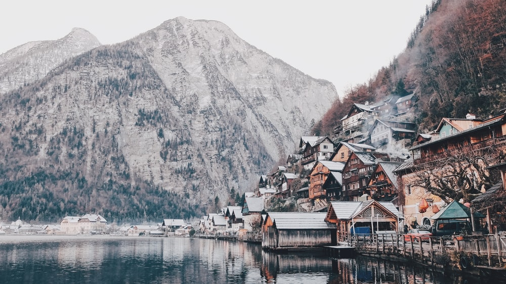 photography of house beside body of water
