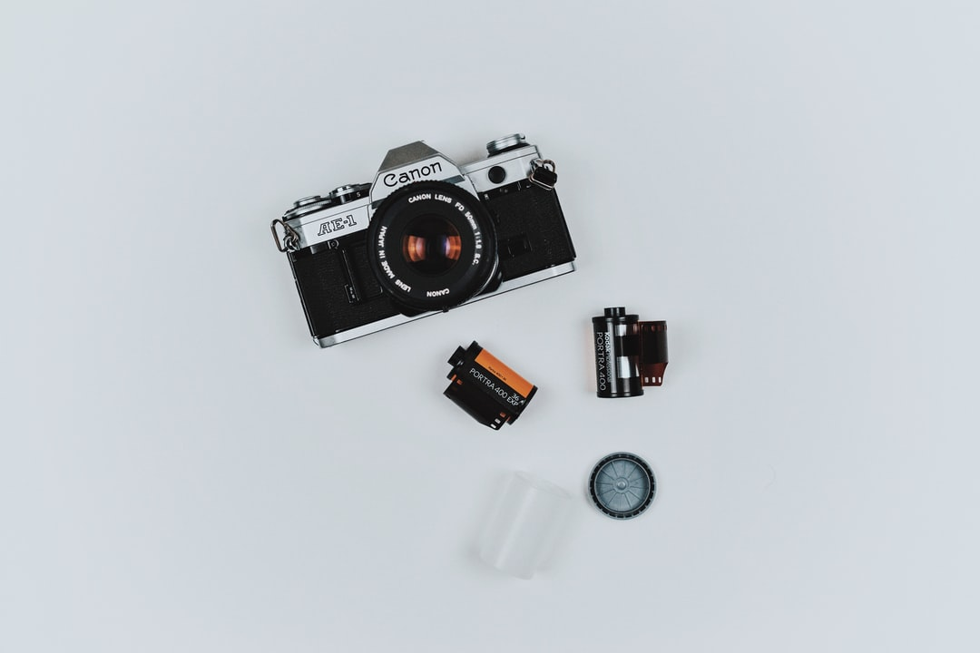 Flat lay of photographer's camera, film, and tools