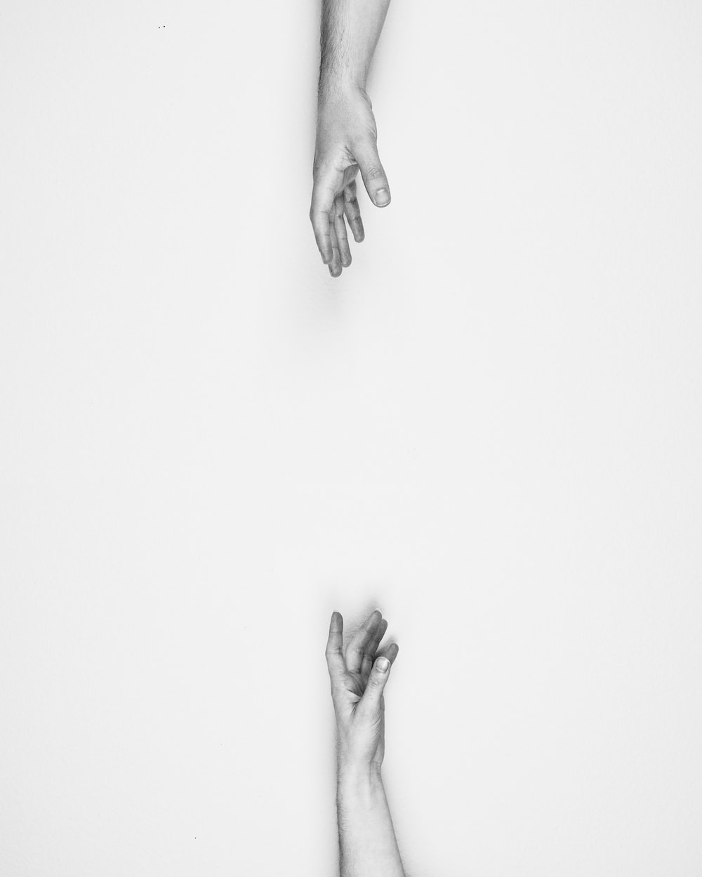 Two hands reaching for each other.