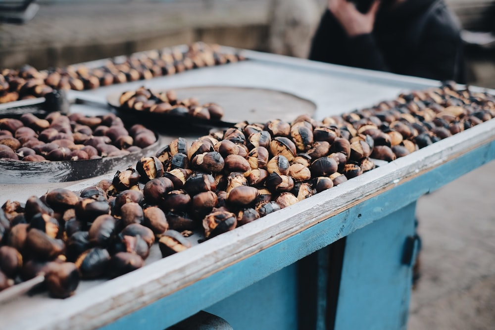 brown and black coffee beans on table
