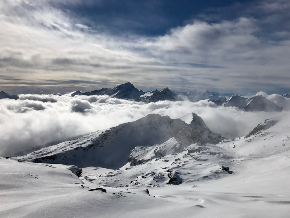 mountain range coated with snow