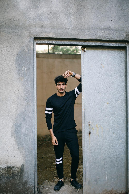 man standing in opened door