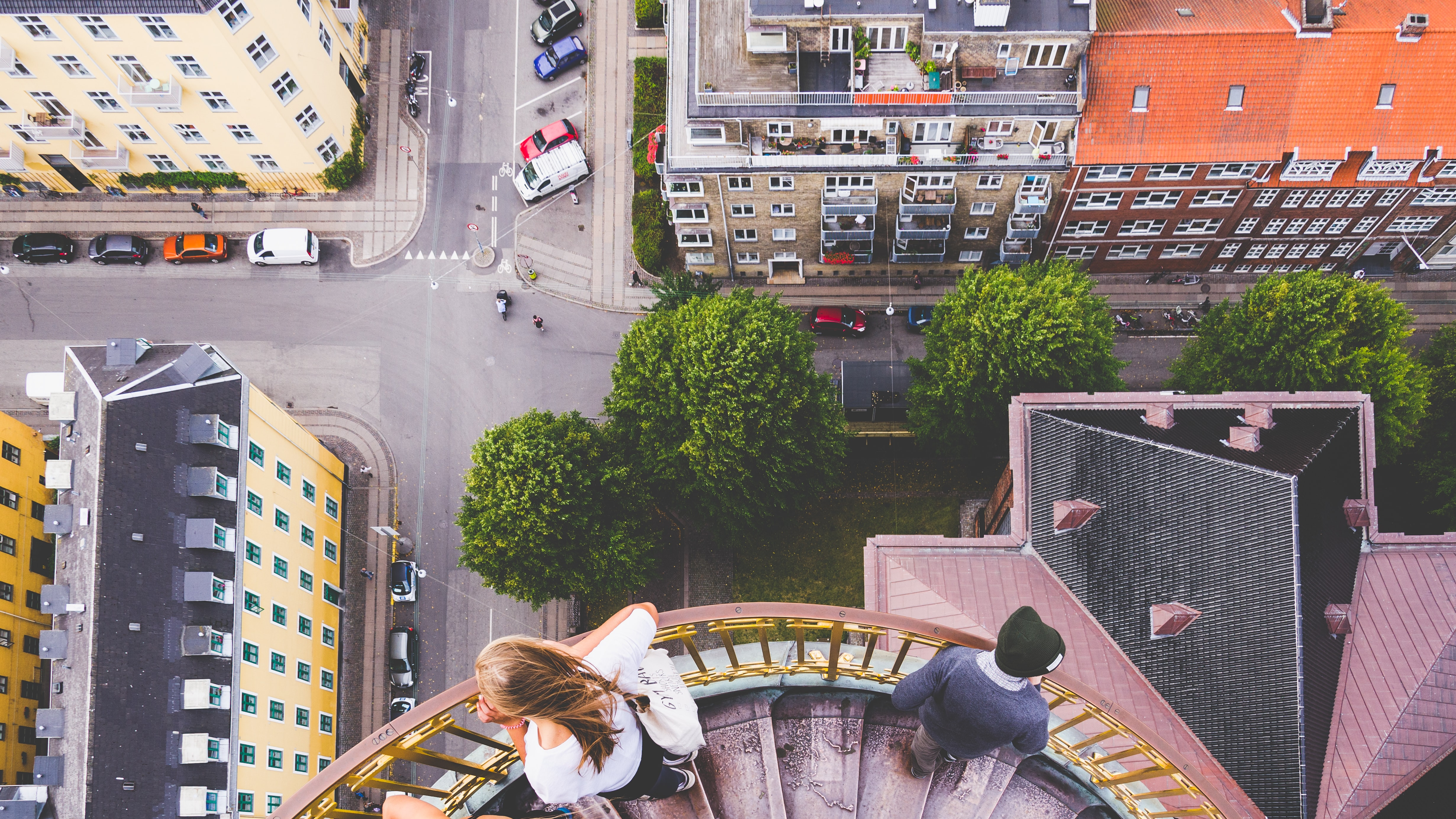 Looking down at the avenue, rooftops and stairs from a building-top at København, Denmark