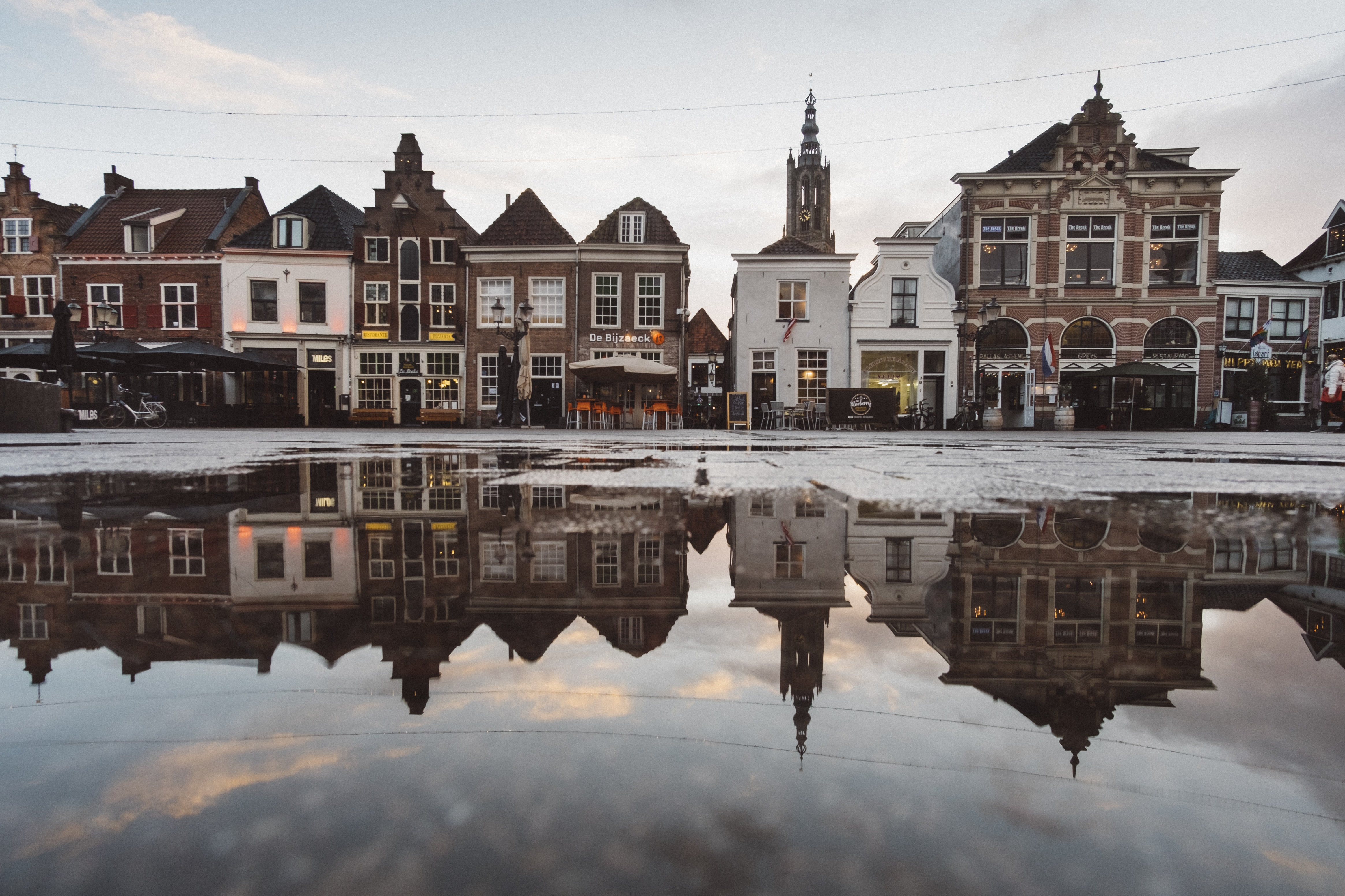 Beautiful puddle reflection of a small artisan town in Europe.