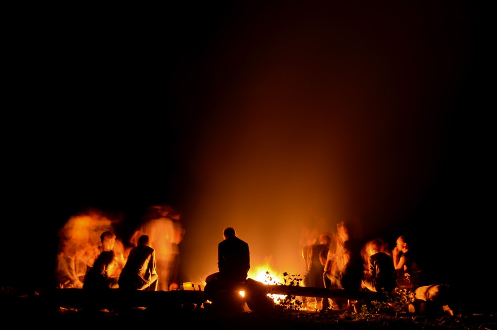people gathered around camp fire at nighttime