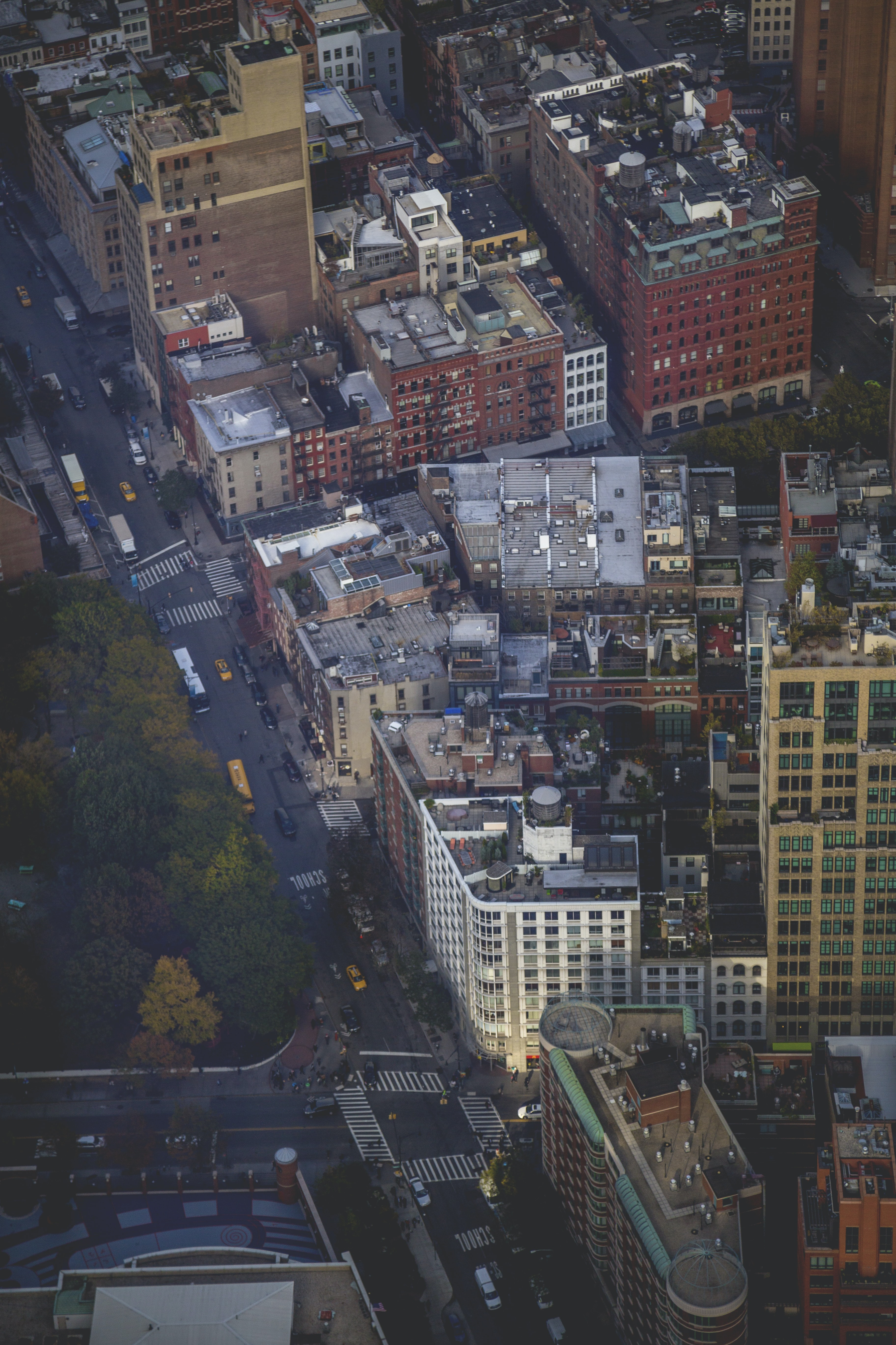 Drone shot of busy Manhattan street with daytime traffic and city buildings
