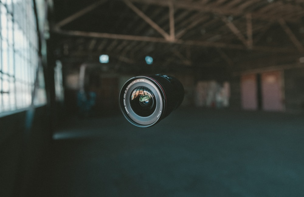 selective focus photography of black zoom lens on mid air