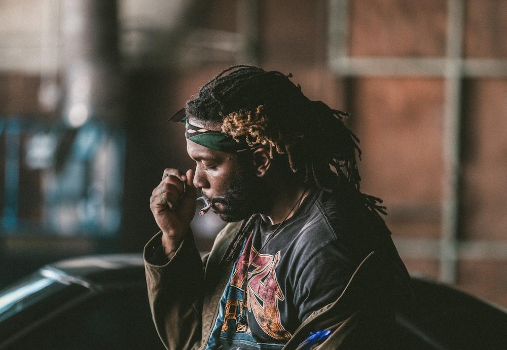 man sitting smoking cigarette