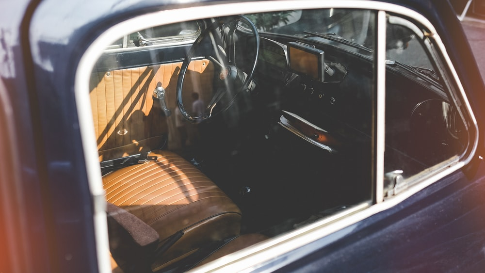 close photo of brown and black vehicle indoor