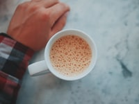 mug with coffee in shallow focus