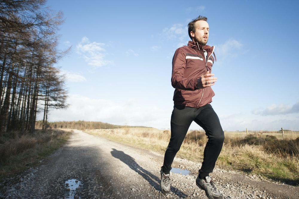 person running to improve health and harmony