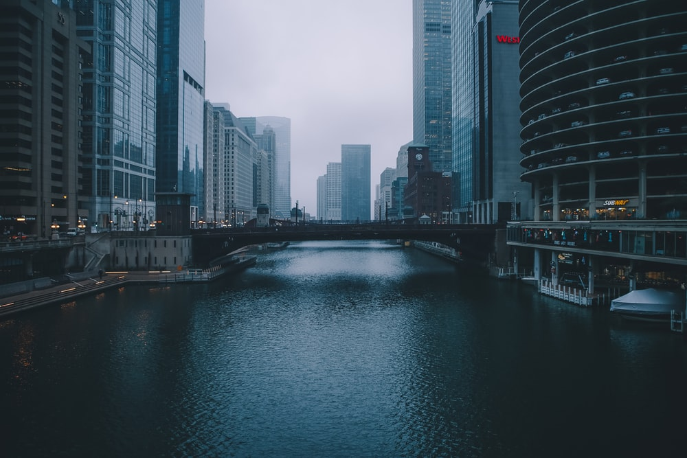 bridge between commercial buildings during daytime