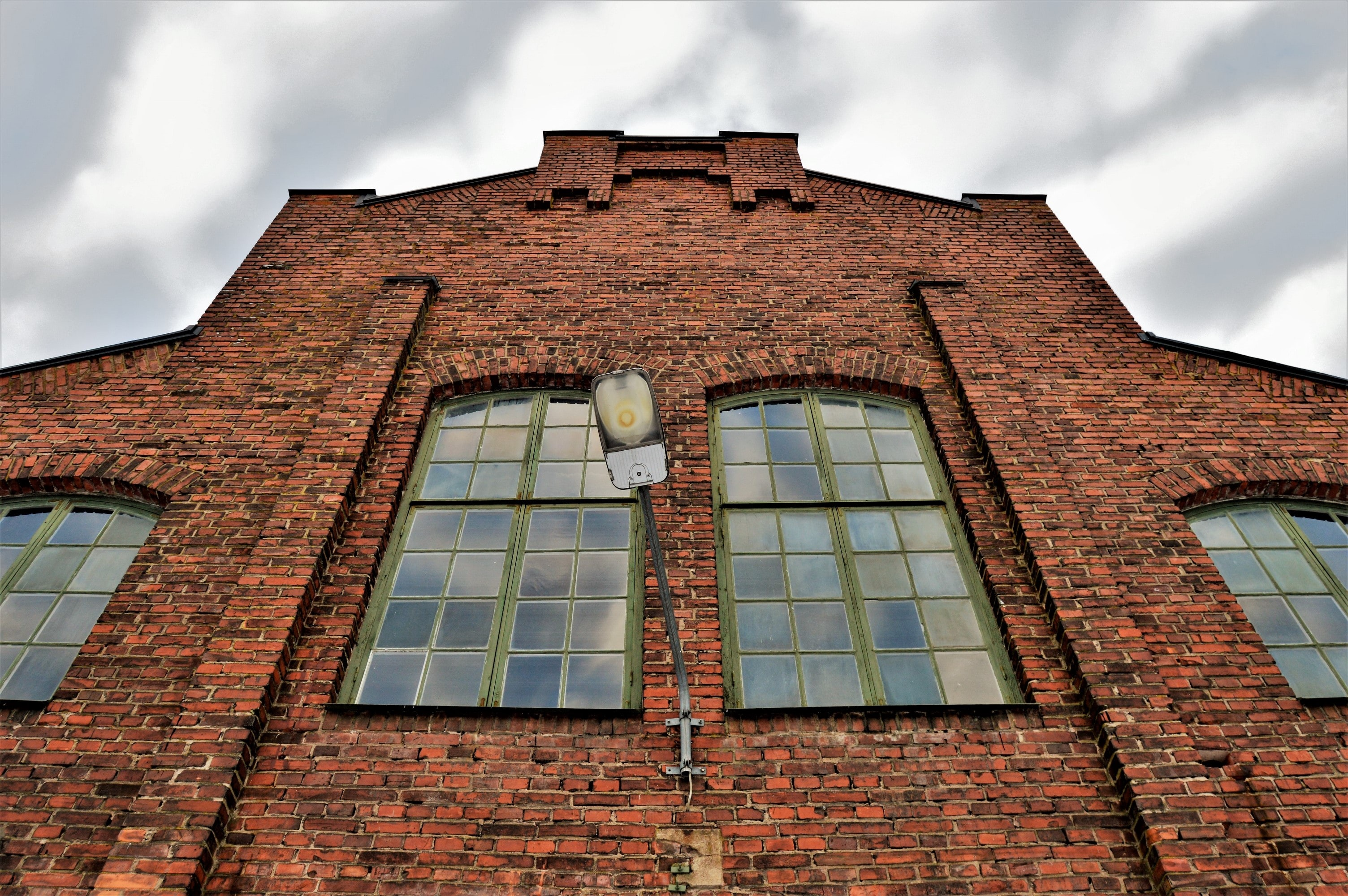 low angle photography of brown painted building