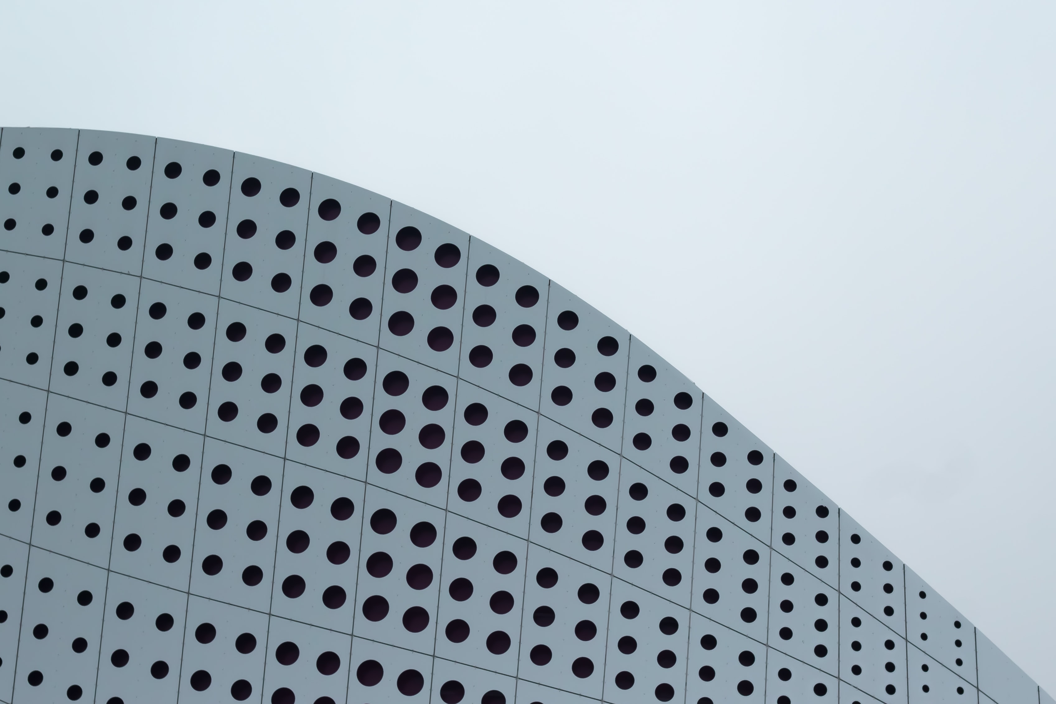 A dotted pattern on a white curved facade