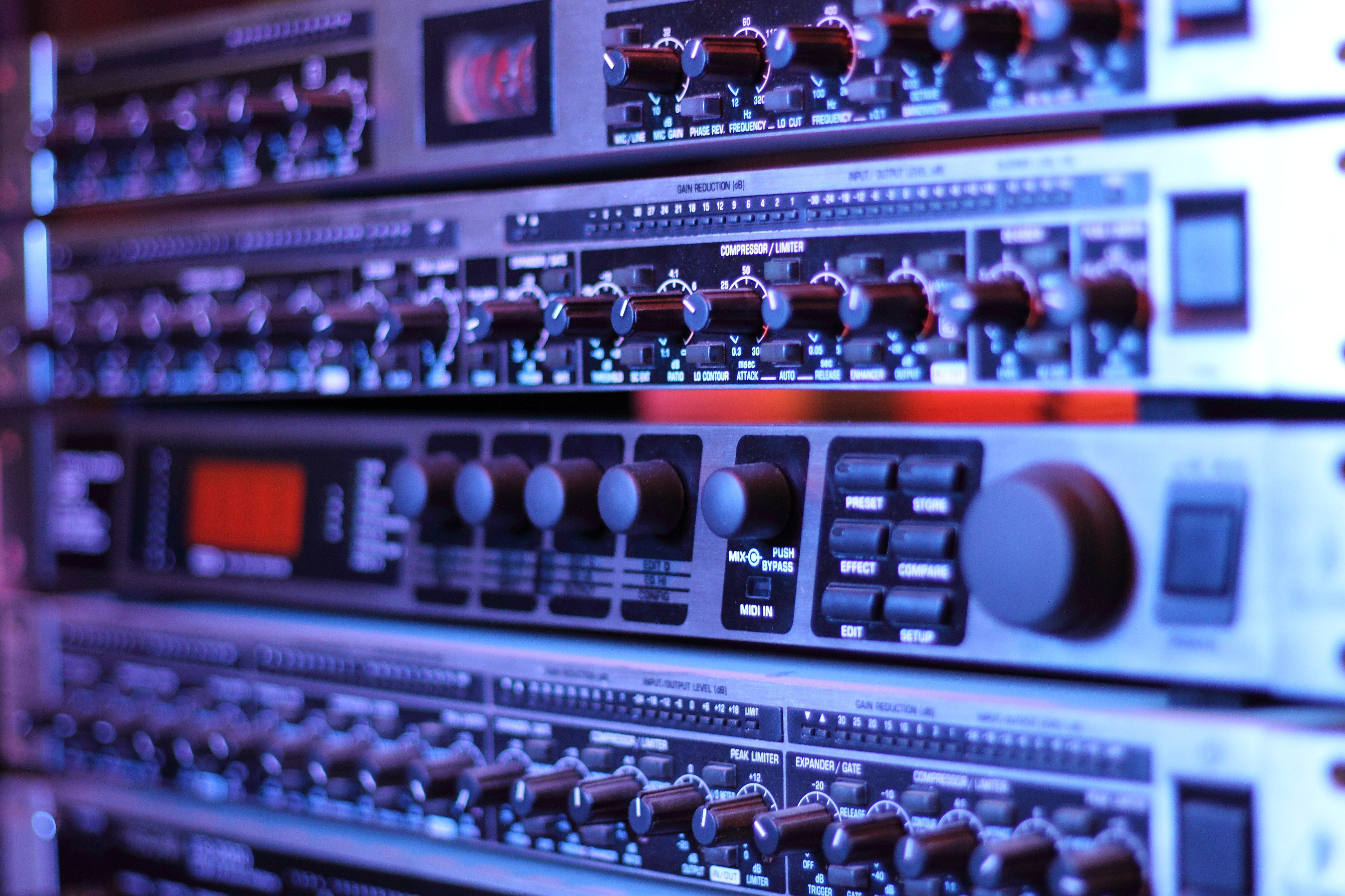A close-up of numerous dials on a piece of recording equipment